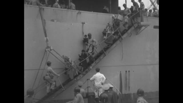 vs doctor and nurses and candy stripers with hospital patient at bedside / vs ship at dock with people at railings refugees carefully walk down... - cracker stock videos and b-roll footage