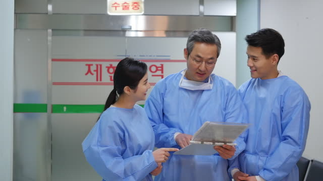 Doctor and nurses having a conversation next to an operating room