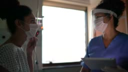 Doctor and patient at hospital room with face mask