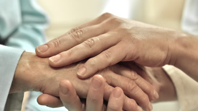 doctor and patient holding hands - care stock videos & royalty-free footage