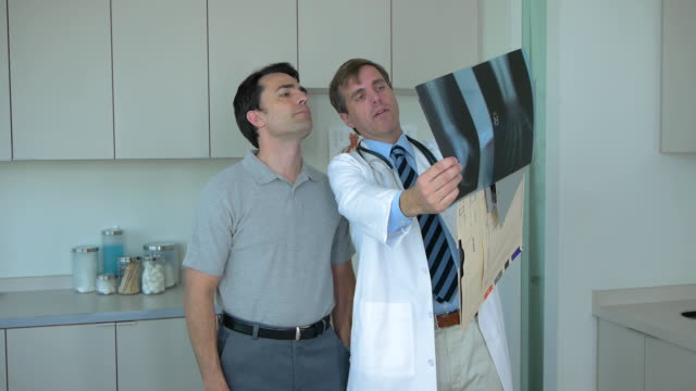 Doctor and patient in doctor's office looking at x-rays