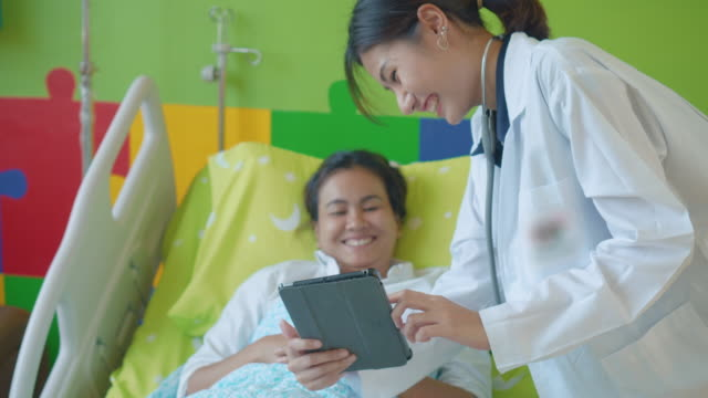 doctor and patient looking at digital tablet - accessibility stock videos and b-roll footage