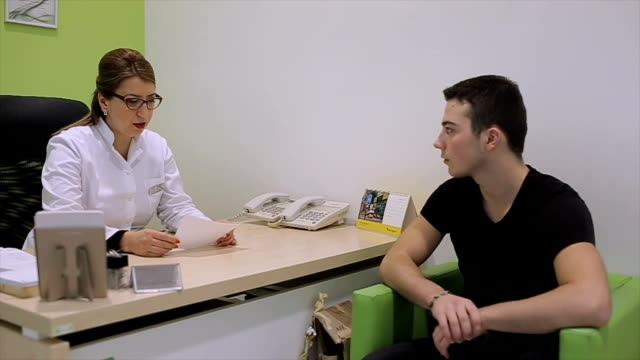 Doctor and patient talk about diagnosis and treatment