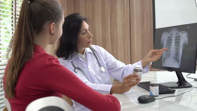 doctor and patient talking - female doctor stock videos & royalty-free footage