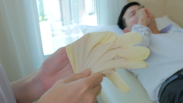 doctor and patient - protective glove stock videos and b-roll footage