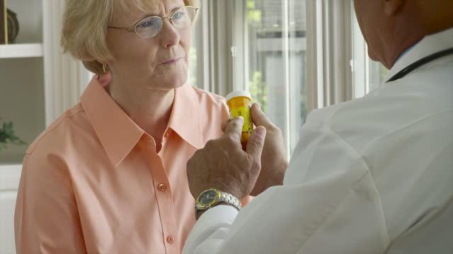 doctor and patient with prescription - prescription medicine bottles stock videos & royalty-free footage