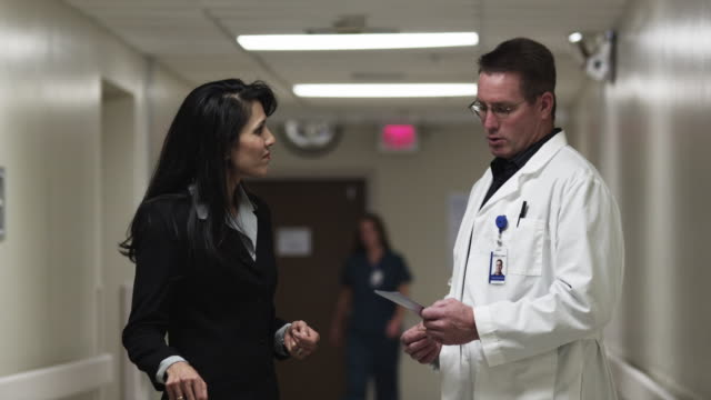vidéos et rushes de ms cu doctor and woman shaking hands in hospital corridor/ payson, utah, usa - payson