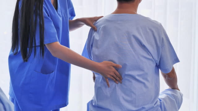 doctor are doing physical therapy to the patient's senior adult. - osteopath stock videos & royalty-free footage