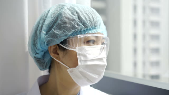 doctor at hospital - protective workwear stock videos & royalty-free footage
