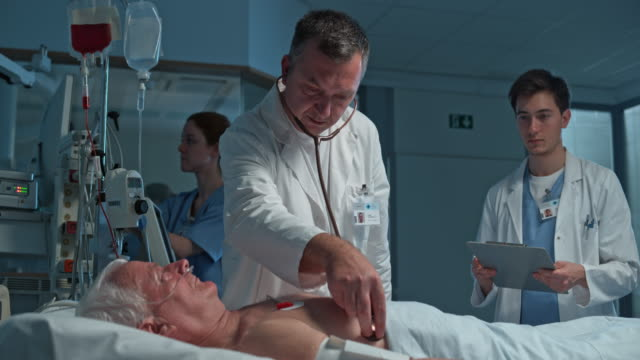 ds doctor auscultating a male senior patient in the intensive care - lung stock videos and b-roll footage