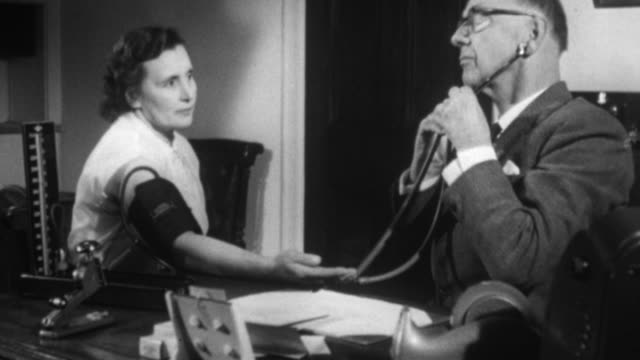 1955 montage doctor checking a patient's blood pressure and heart rate / united kingdom - blood pressure gauge stock videos & royalty-free footage