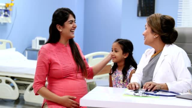 vídeos de stock, filmes e b-roll de doctor checking a pregnant woman in hospital, delhi, india - cuidado pré natal