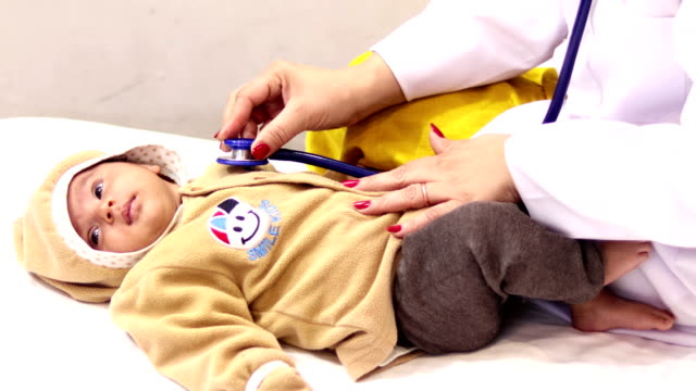 doctor checking baby heartbeat - stethoscope stock videos & royalty-free footage