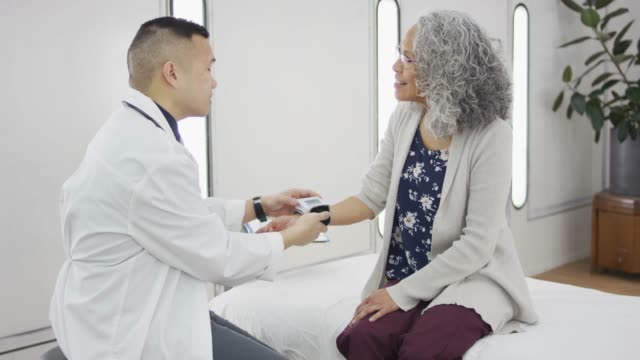 Doctor Checking Blood Pressure of Older Woman