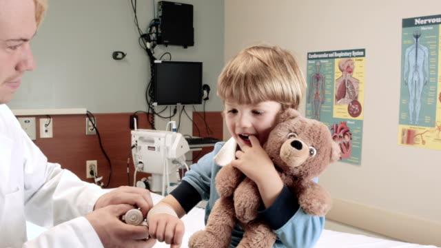 Doctor Checking Little Boy's Wrist