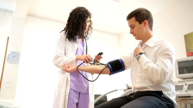 Doctor checking patient pressure