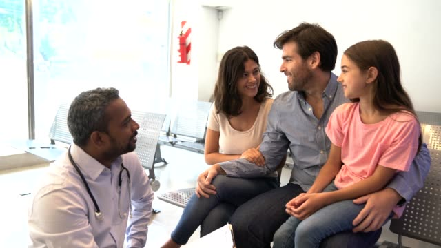 doctor discussing with girl's family at hospital - waiting room stock videos & royalty-free footage