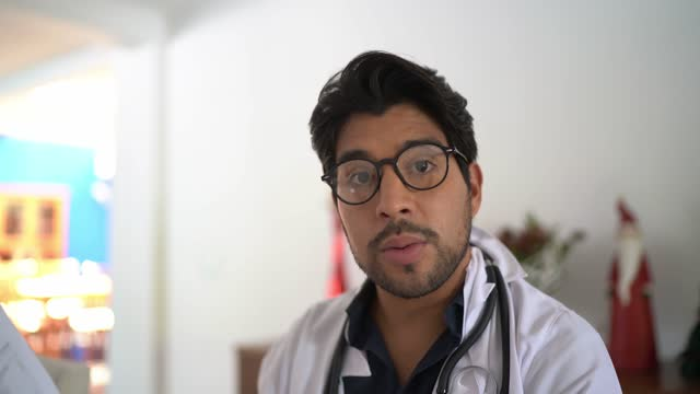 doctor doing a video call or telemedicine - camera point of view - mid adult men stock videos & royalty-free footage