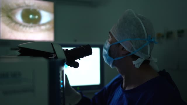 doctor doing an exam or surgery, looking at images in onitor - operation stock videos & royalty-free footage