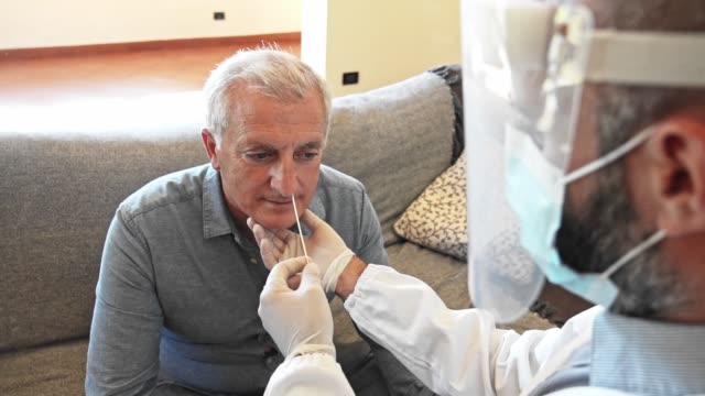 doctor doing the tampon to a patient at home - tampon stock videos & royalty-free footage