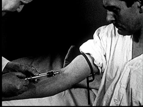1953 ms doctor drawing blood from patient's arm/ norman, oklahoma - blood donation stock videos & royalty-free footage