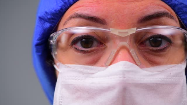doctor during coronavirus covid 19 novel corona virus outbreak - female doctor stock videos & royalty-free footage