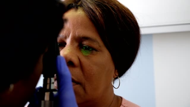 doctor examines the patients eye - nursing student stock videos and b-roll footage