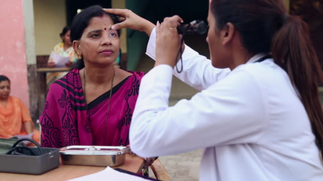 Doctor examining a patient in the hospital, Sonipat, Haryana, India