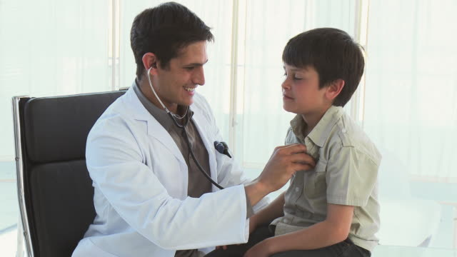 ms doctor examining boy (8-9) using stethoscope / cape town, south africa - see other clips from this shoot 1796 stock videos & royalty-free footage