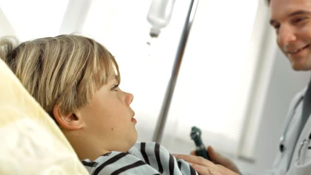 HD: Doctor Examining Boy's Ear