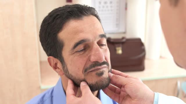 HD: Doctor Examining Senior Man's Neck
