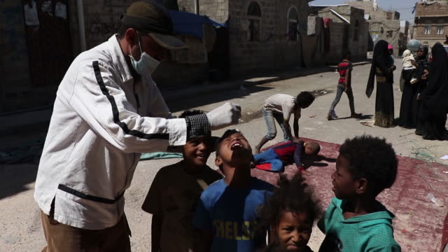 doctor gives children oral cholera vaccinations on september 19, 2019 in sana'a, yemen. yemen's local health authorities, with support from the world... - vibrio stock videos & royalty-free footage