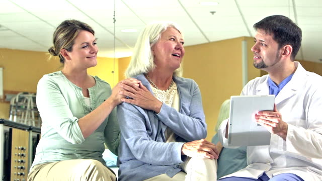Doctor gives good news to patient and her adult daughter