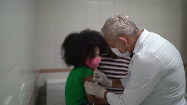 doctor giving a vaccination shot to a little girl patient - child stock videos & royalty-free footage