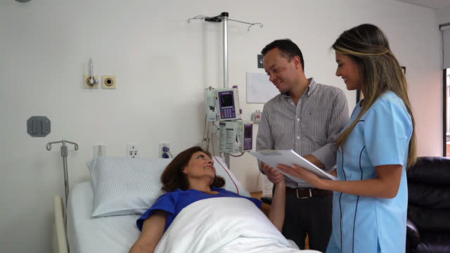 Doctor giving good news to a hospitalized patient