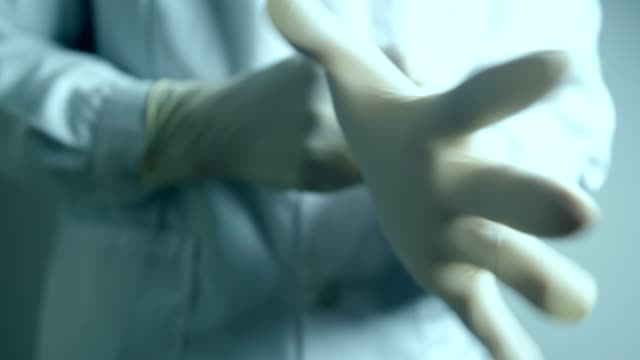 doctor hands wearing protective gloves - latex glove stock videos & royalty-free footage