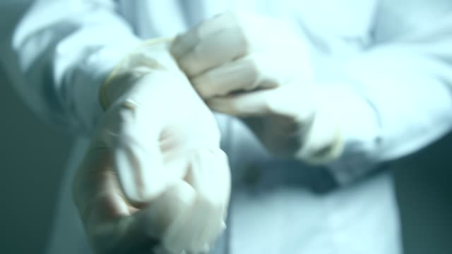 doctor hands wearing protective gloves - rubber glove stock videos & royalty-free footage