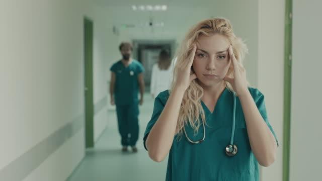 doctor having headache - head in hands stock videos & royalty-free footage