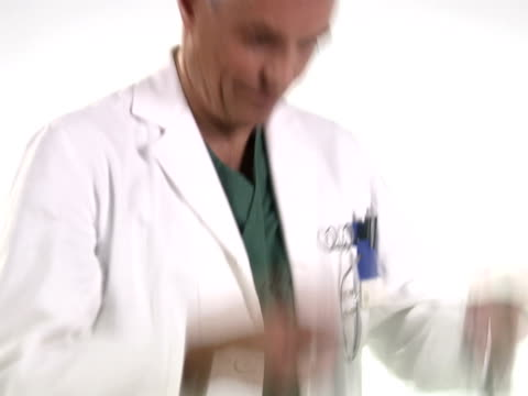 a doctor holding a stethoscope. - strumento medico video stock e b–roll