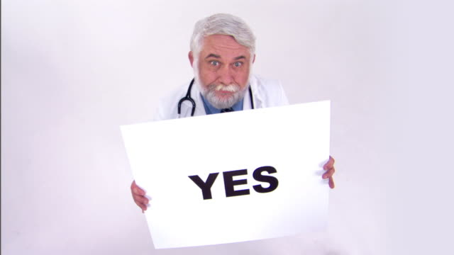 stockvideo's en b-roll-footage met doctor holding yes sign - sign