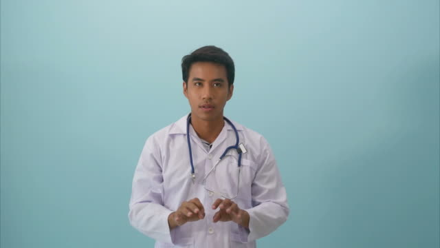 doctor in face expression , typing , index finger in air - index finger stock videos & royalty-free footage