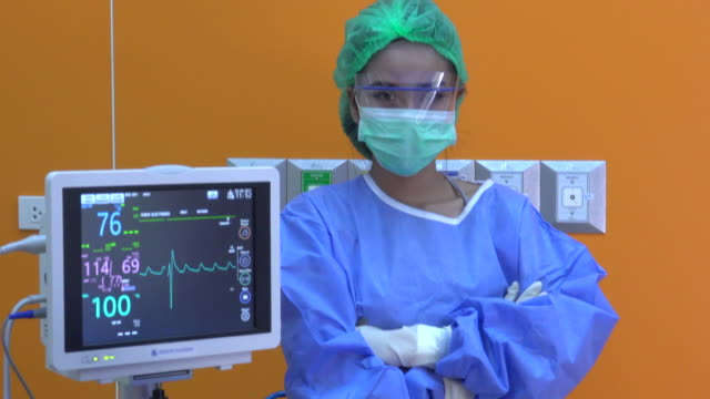 doctor in operating room - disposable gloves stock videos and b-roll footage