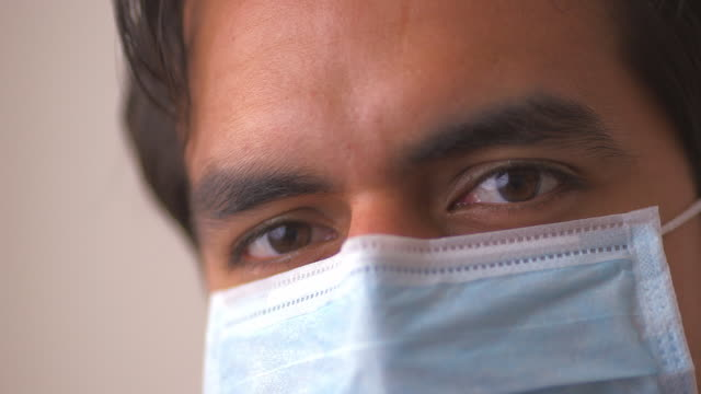 doctor in surgical mask - surgical mask stock videos and b-roll footage