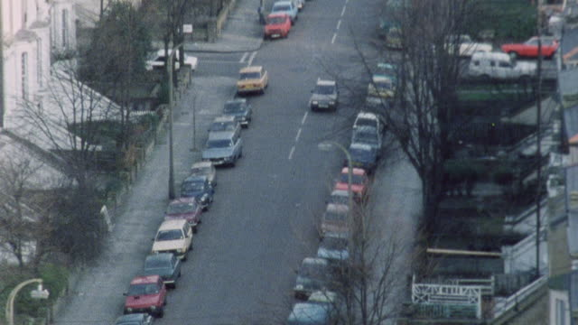 1983 montage doctor iona heath driving down a street in kentish town, arriving at her destination, and parking / london, england - kentish town stock videos & royalty-free footage