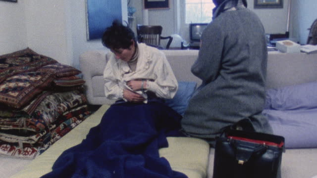1983 ms doctor iona heath performing home visit in a patient's apartment / london, england - kentish town stock videos & royalty-free footage