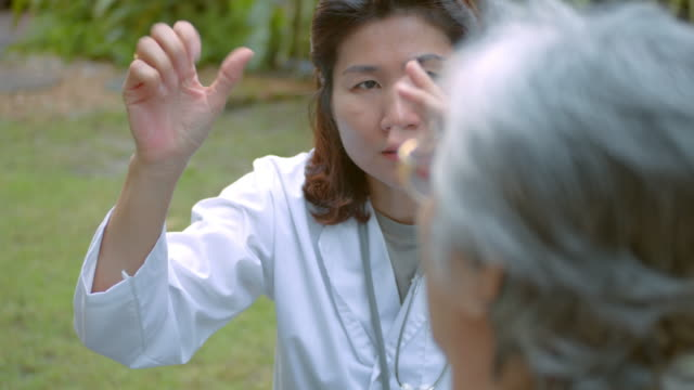 doctor is assisting and recommending senior woman with hand exercise,slow motion - rheumatism stock videos & royalty-free footage