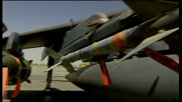 raf doctor jailed for refusing to go to iraq file / date unknown location unknown ext british soldier checking missile on fighter jet fighter jet... - raf stock videos and b-roll footage