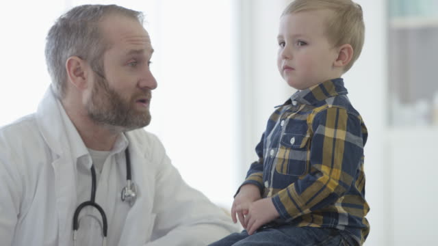 doctor listening to a little boy's heartbeat - pediatrician stock videos & royalty-free footage