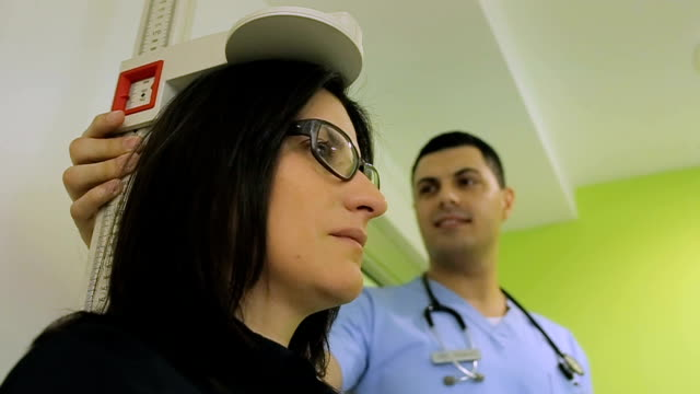 doctor measuring patients height - overweight doctor stock videos & royalty-free footage