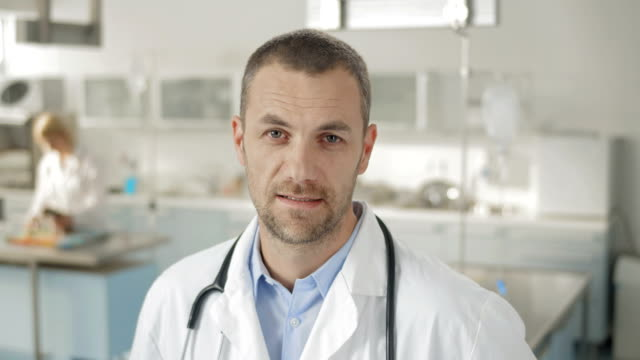 doctor nodding at the camera - laboratory coat stock videos & royalty-free footage